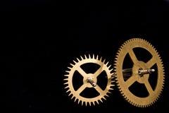 Dientes del reloj de Steampunk en fondo negro Fotos de archivo