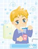 Dientes que aplican con brocha del muchacho Fotos de archivo