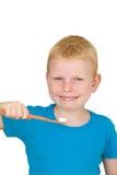 Dientes que aplican con brocha del muchacho Fotografía de archivo