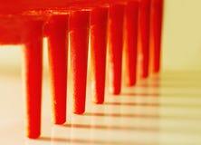 Dientes rojos con su sombra Imagenes de archivo