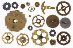 Dientes viejos del mecanismo y piezas del reloj - aisladas Imagen de archivo libre de regalías