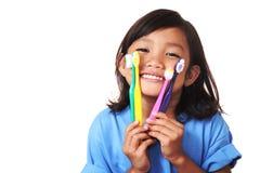 Dientes y cepillo de dientes Imagenes de archivo