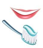 Dientes y cepillo de dientes Foto de archivo