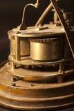 Dientes y engranajes de un reloj viejo Foto de archivo libre de regalías