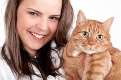 Dierenarts en kat Stock Foto