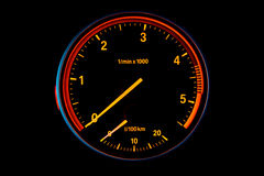 Diesel car tachometer. Illuminated Diesel car tachometer isolated on black background Stock Image