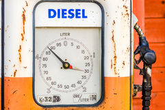 Diesel. Detail of and old vintage diesel pump in orange and white. Handle at right side. Volume shown in liters on circular information board stock photo