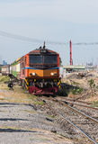 Diesel electric locomotive of rapid train. Is passing the construction site to urban station Stock Image