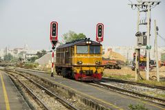 Diesel Electric old locomotives of Thailand. BANGKOK, THAILAND - 1 Feb 2018 : Old yellow electric locomotive ` Alsthom ` run enter junction Bang Sue train Royalty Free Stock Images