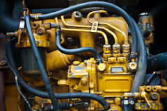 Diesel Engine. Close up on a diesel engine that used in a backhoe stock images