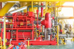 Diesel engine fire water pump at offshore oil and gas construction platform. Firefighting system on offshore oil and gas platform and petrochemical industry Stock Photos
