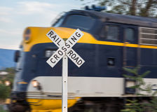 Diesel engine with railroad crossing sign Stock Photography