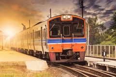 Diesel engine trains on track ways station against beautiful dus Royalty Free Stock Photos