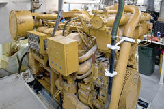 Diesel engine on yacht. Details of a large diesel engine aboard a yacht stock images