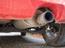 Diesel exhaust, old red car. Detail. Emissions problem. Stock Photography