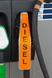 Diesel fuel nozzle at gas station Stock Images