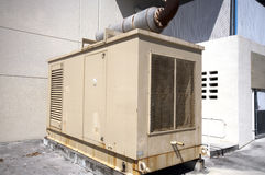 Diesel Generator Stanby Unit. Diesel powered stanby emergency Generator unit on the exterior of a building ready in case of power failure Stock Photo