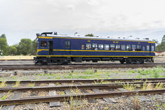 Diesel locomotive carrying passengers Stock Photography