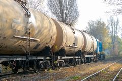 Diesel locomotive delivering oil in tanks royalty free stock images