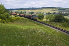 Diesel locomotive with freight cars Stock Photography