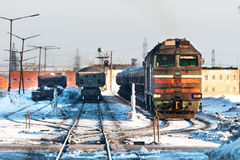 Diesel locomotive with freight trains at the railway station. Stock Images