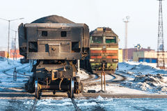 Diesel locomotive with freight trains at the railway station. Royalty Free Stock Photography