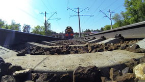 Diesel locomotive RZD (russian railway) passes over the extreme camera. Russia. Moscow region. Extreme camera is mounted under the diesel locomotive on the stock video footage