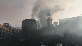 Diesel locomotive starts in depot and smokes heavily stock footage