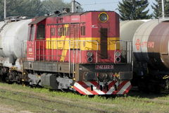 Diesel locomotive with tank car train in Slovakia. TREBISOV/SLOVAKIA - AUGUST 30, 2015: Diesel locomotive of Slovak railway hauls a tank car train at the station stock photo