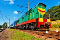 Diesel passenger train. Close view of diesel passenger train passing by stock photos