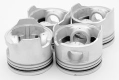 Diesel pistons. Four pistons - spare parts of a diesel engine stock photos