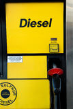 Diesel pump. Nozzle on Canadian gas station Stock Photos