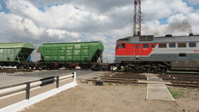 Diesel railcars travelling through moving. The locomotive travels through the crossing. stock video