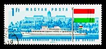 Diesel Ship Hunyadi, Buda Castle, Hungarian Flag, Danube Commission serie, circa 1967. MOSCOW, RUSSIA - NOVEMBER 26, 2017: A stamp printed in Hungary shows royalty free stock photography