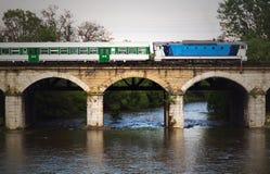 Diesel train on a bridge Stock Photos