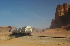 Diesel train in desert. Deisel train in rocky desert Royalty Free Stock Photo