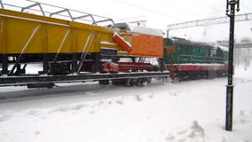 Diesel train motion in snow. Motion of train in snowstorm stock footage