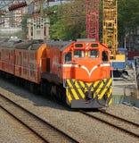 Diesel Train Passes Construction Site Stock Photos
