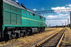 The diesel train on railroad. The diesel train go on railroad Royalty Free Stock Photography