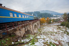 Diesel train traveling on the viaduct Royalty Free Stock Images