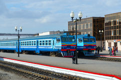 Diesel trains on ways of train station, Mogilev, Belarus. MOGILEV, BELARUS - APRIL 25, 2015: Unidentified people are waiting to board in diesel trains on the Royalty Free Stock Photography