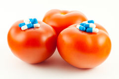 Diet. Tablets placed on fresh tomatoes Stock Images