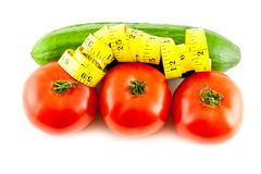 Diet. Measure with tomatoes and cucumber on a white background Royalty Free Stock Photos