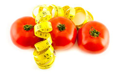 Diet. Measure with tomatoes on a white background Stock Image