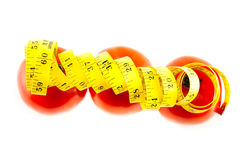 Diet. Measure with tomatoes on a white background Royalty Free Stock Photos