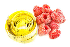 Diet. Measure with raspberry on a white background Royalty Free Stock Photography