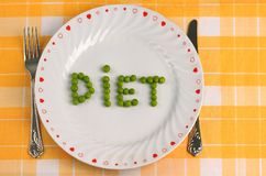 Diet. The word diet spelled with peas on a plate Stock Image
