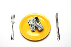Diet. Concept of extreme dieting. Empty dish and measuring tape Stock Photos