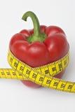 Diet. Measuring tape, red vegetable, diet Stock Photo