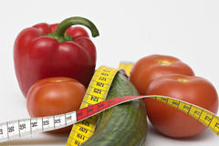 Diet. Vegetables, healthy food, measuring tape, diet Stock Photography